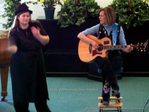 Cindy Freeman signing; Jana Stanfield singing (photo)